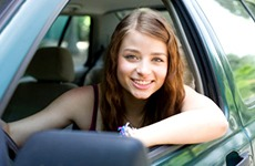 Young college student driving a car